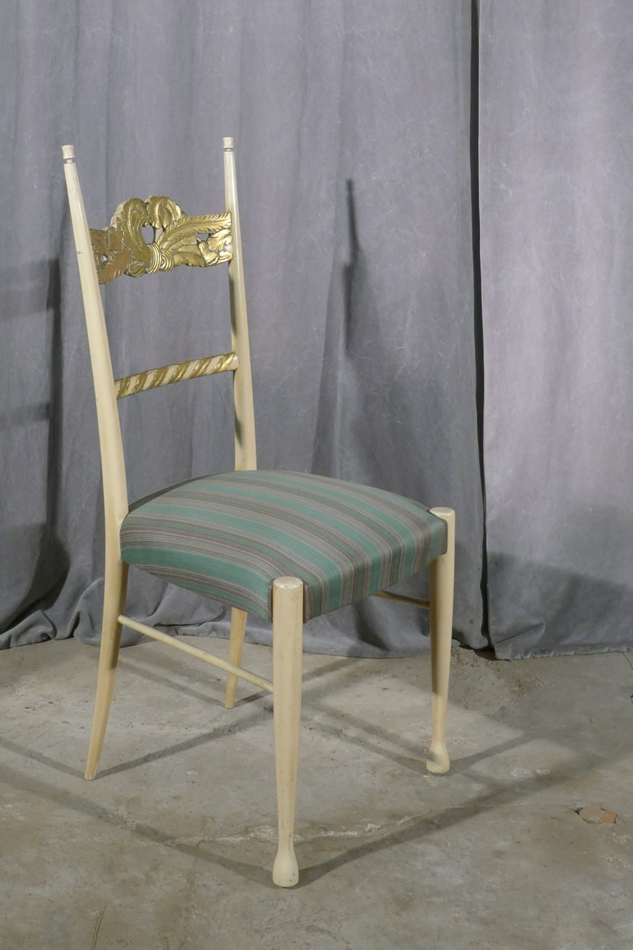 a set of four chairs by Paolo Buffa and Giovanni Gariboldi